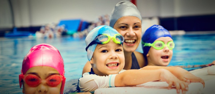 Kids Wearing Swim Caps With Instructor